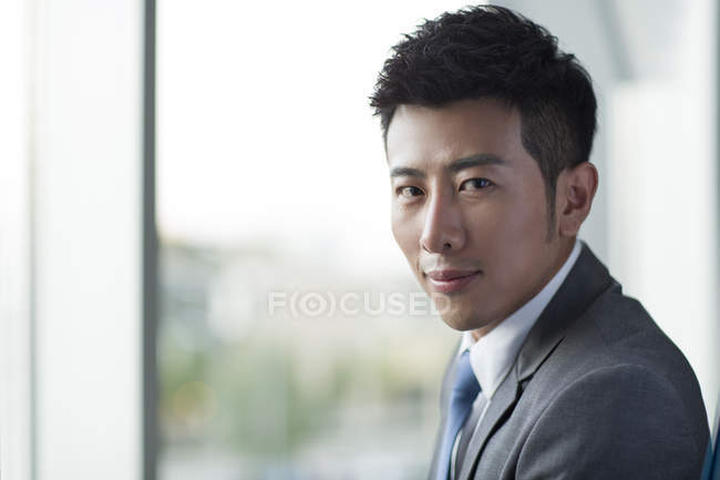 Portrait of chinese businessman looking in camera — Stock Photo