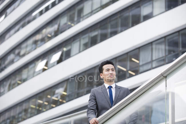 Chinese businessman looking at view and thinking — Stock Photo