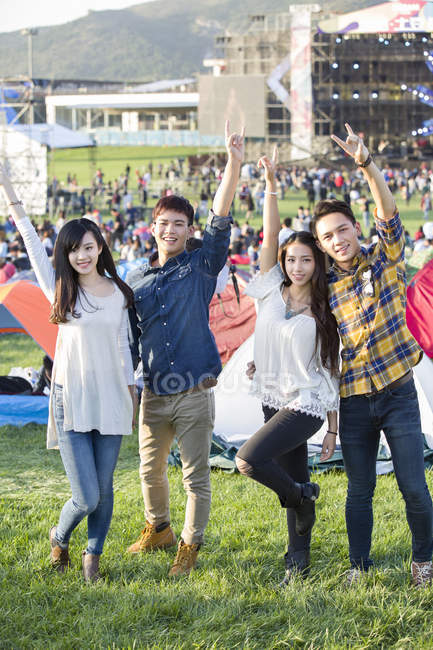 Chinese friends having fun at music festival camping — Stock Photo