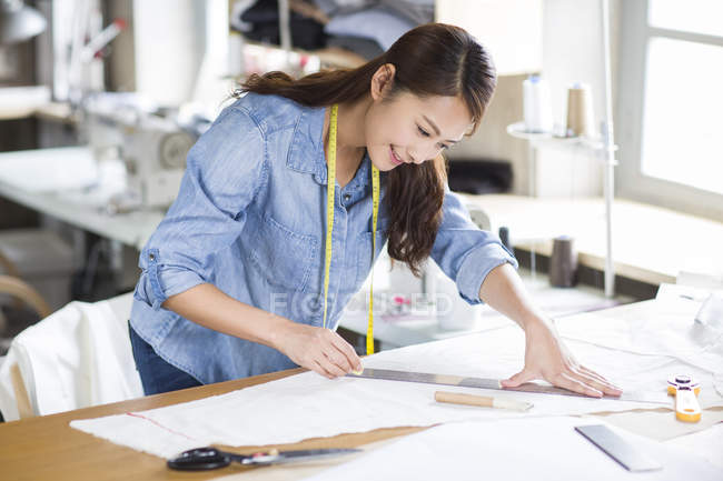 Chinese Fashion Designer Measuring Textile In Studio Cheerful Tools Stock Photo 183038244