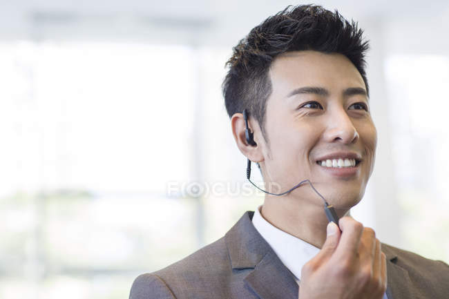 Chinese sale manager using headset — Stock Photo
