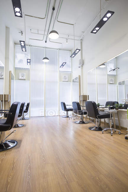 Barber shop interior with empty chairs — Stock Photo