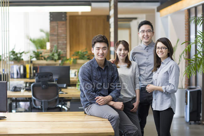 Team of IT workers posing together in office — Stock Photo