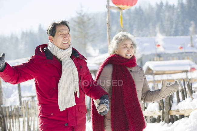 Chinese senior couple walking together at village — Stock Photo