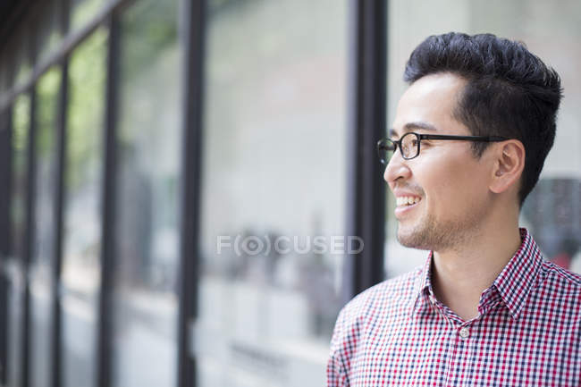 Side view of chinese man looking away — Stock Photo