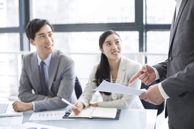 Chinese business people talking at meeting — Stock Photo