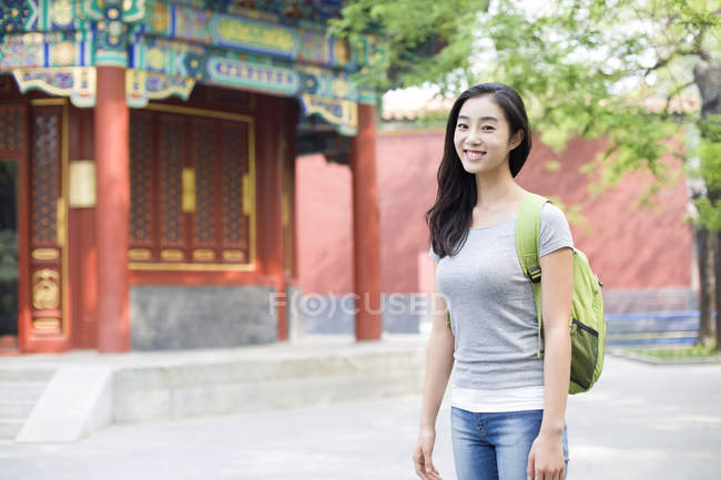 22c99ca4ed Chinese woman with backpack visiting Lama Temple — selective focus ...