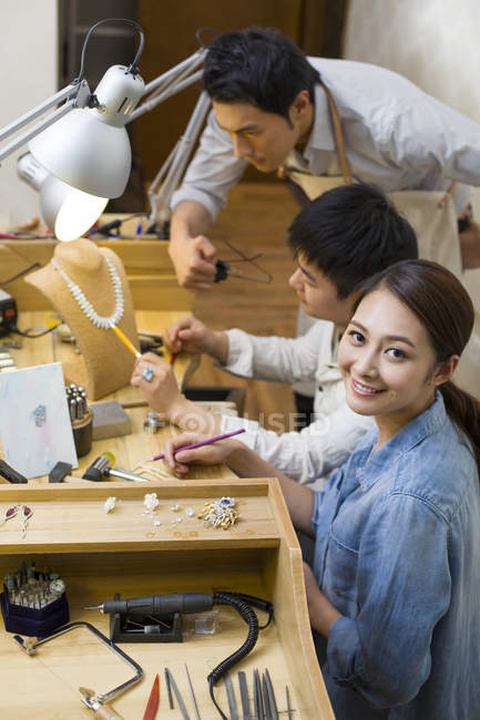 Chinese jewelers working on ring design in studio — Stock Photo