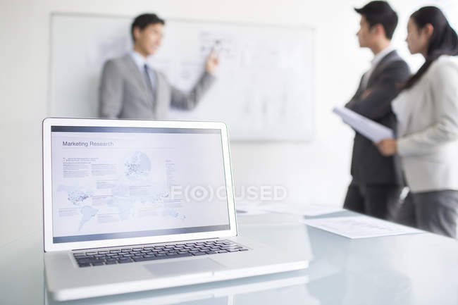 Laptop with business research on office desk — Stock Photo