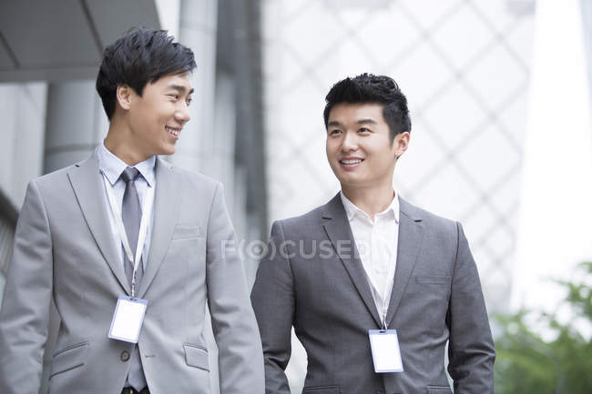 Chinese businessmen talking at business centre — Stock Photo
