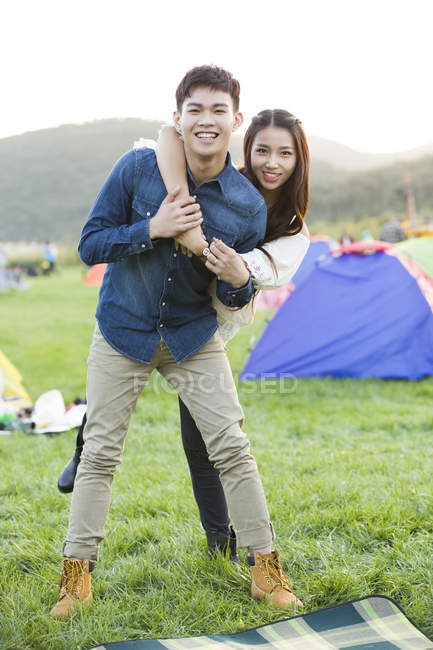 Chinese couple posing on festival lawn — Stock Photo
