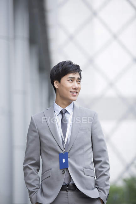 Chinese businessman standing on street — Stock Photo