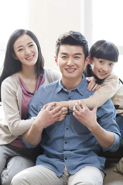 Portrait of cheerful chinese family — Stock Photo