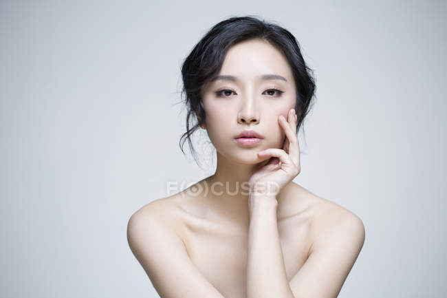 chinese woman posing with hand on chin stock photo 184809168