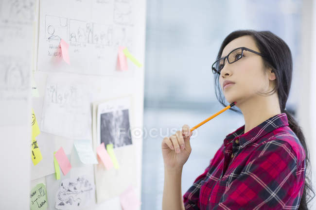 Chinese female designer working in office — Stock Photo