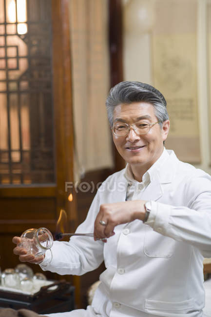 Chinese Doctor Performing Cupping Therapy Medical