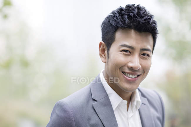 Portrait of smiling chinese businessman — Stock Photo