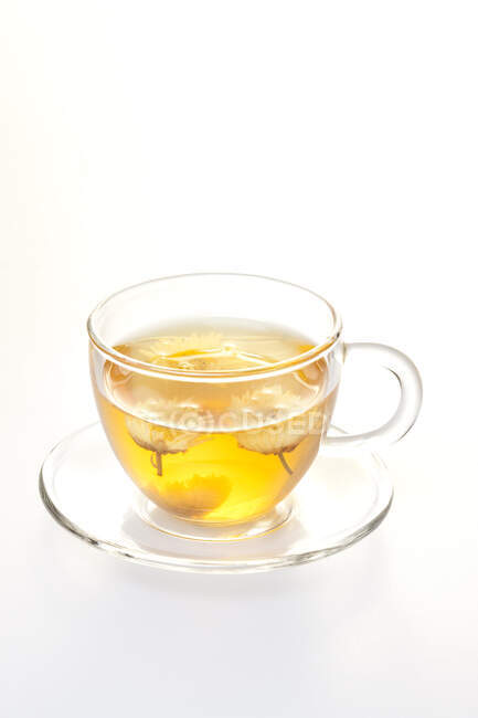 Cup of jasmine tea isolated on white background — Stock Photo