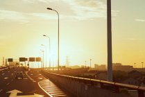 Traffic on highway at sunrise — Stock Photo