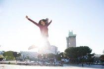 Woman jumping on street — Stock Photo