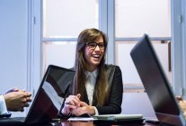 Businesswoman discussing work with colleagues — Stock Photo