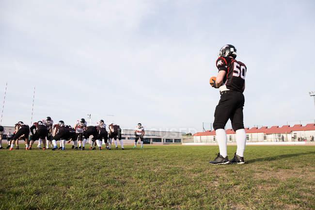 Football player holding ball — Stock Photo