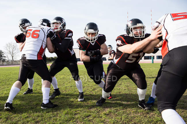 Football players fighting for ball — Stock Photo