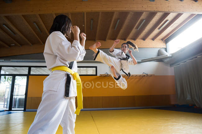Women practicing hapkido in gym. — Stock Photo