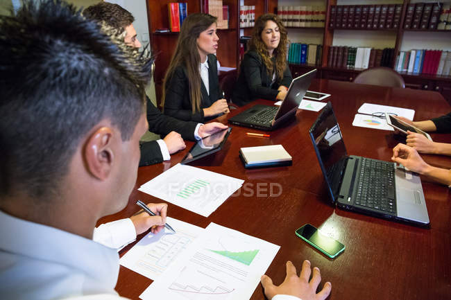 Employee taking notes at meeting — Stock Photo