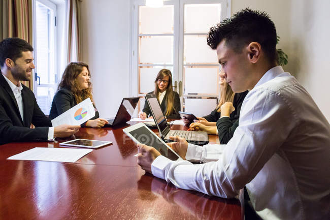 Businessman working with digital tablet — Stock Photo
