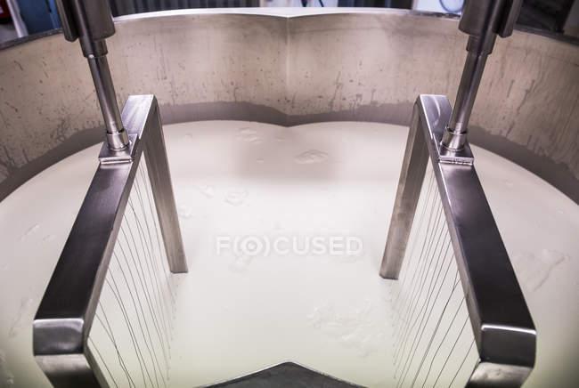 Mixing machine at cheese making workshop — Stock Photo
