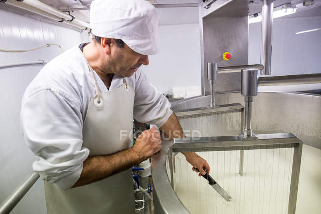 Worker cutting raw materials — Stock Photo