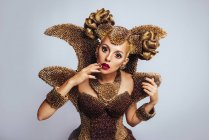 Portrait of woman with fantasy makeup and hairstyle — Stock Photo