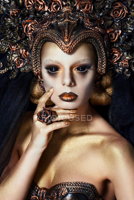 Portrait of woman with fantasy makeup and black lenses — Stock Photo
