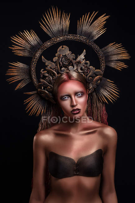 Portrait of woman with fashion makeup and body art wearing crown — Stock Photo