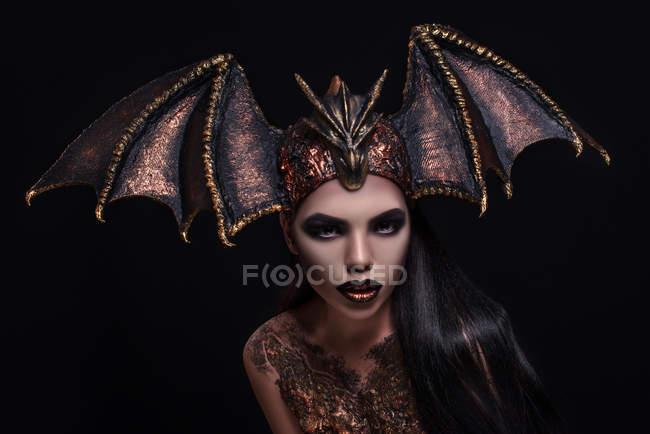 Woman with fashion makeup wearing dragon style crown — Stock Photo