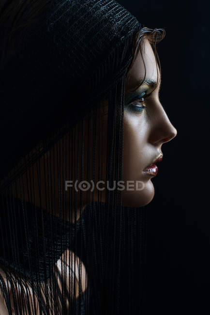 Profile of woman with fashion makeup and hairstyle — Stock Photo