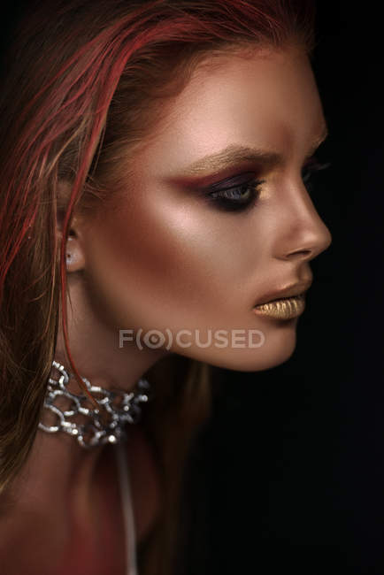 Portrait of woman with fantasy makeup and chain on neck — Stock Photo