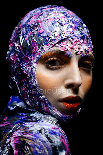 Young beautiful woman with creative make up and fancy costume posing — Stock Photo