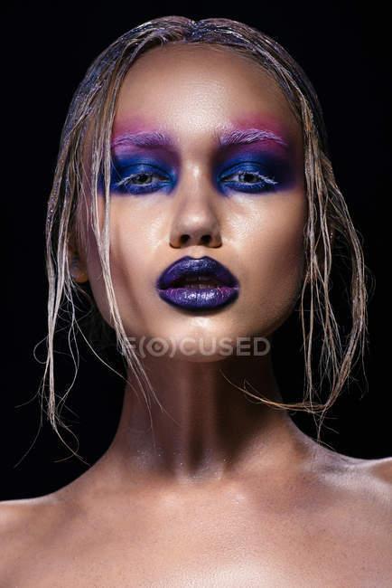 Fashionable woman with creative make up  posing — Stock Photo