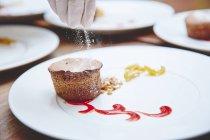 Chef decorated delicious muffin — Stock Photo