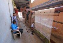 Невиразне текстильні працівників плетіння в бурштину (передмістя Джайпур). Індія. Раджастхан держави — стокове фото