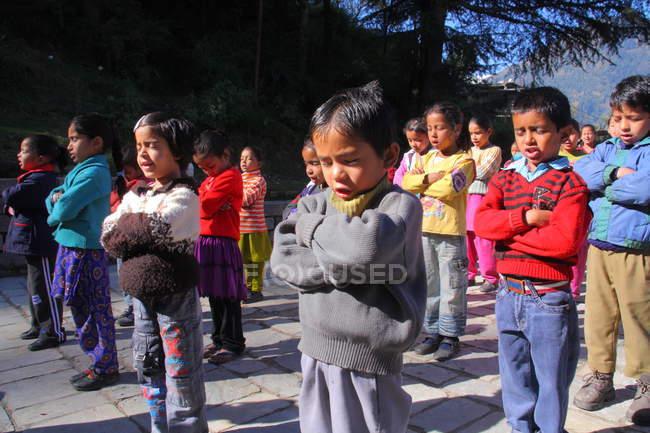 Children on morning prayer — Stock Photo