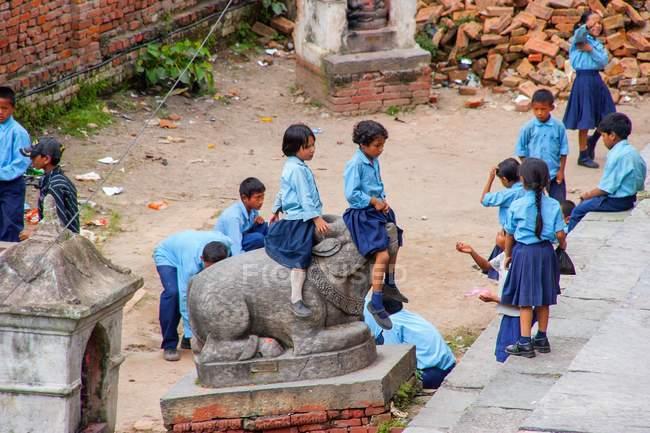 Children in school uniform playing — Stock Photo