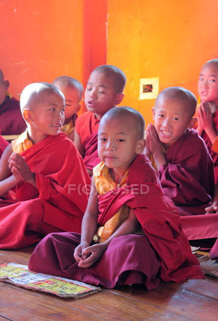 Young novice monks looking at camera — Stock Photo