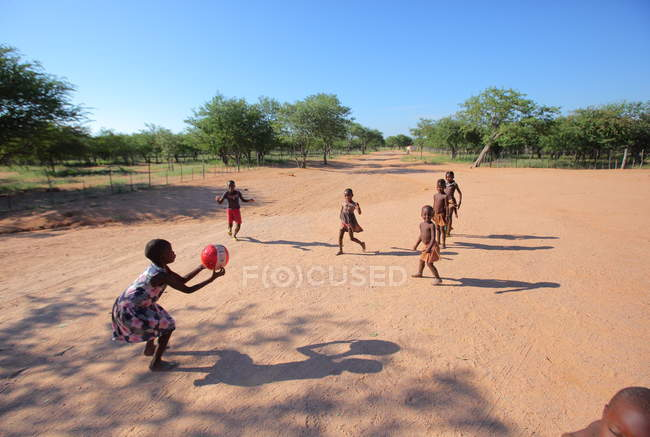 Kids play football in Village School — Stock Photo