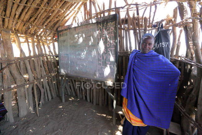 Teacher in School of Maasai tribe — Stock Photo