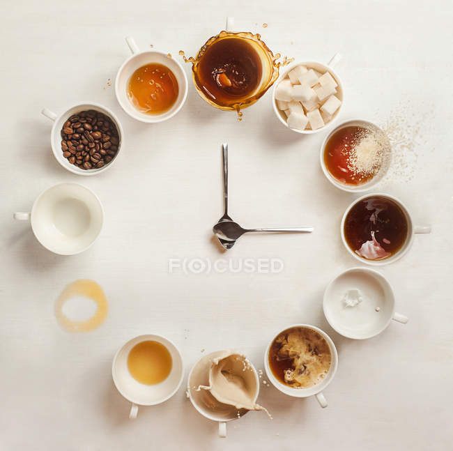 Coffee cups clock face — Stock Photo