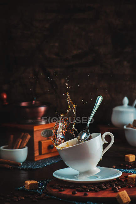 Cup of tea with splashes around — Stock Photo