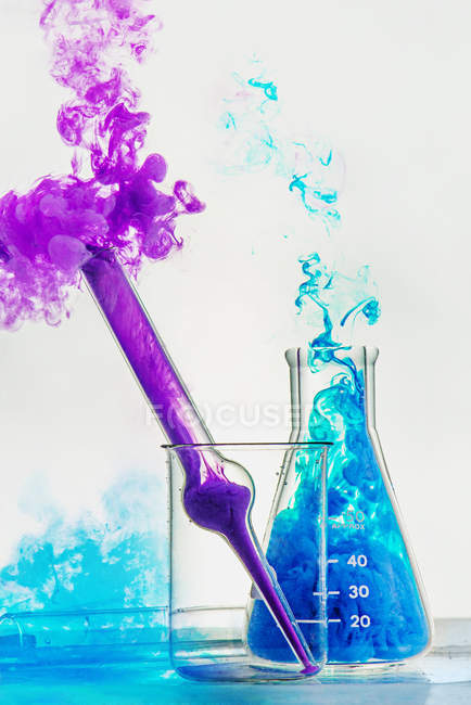 Bottles with color smoke — Stock Photo